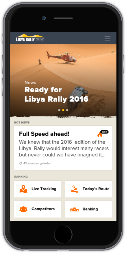 Phone with Libya App on screen.